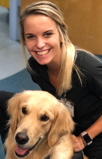 Facility dog Farleywith ER Tech Elissa in theEmergency Department