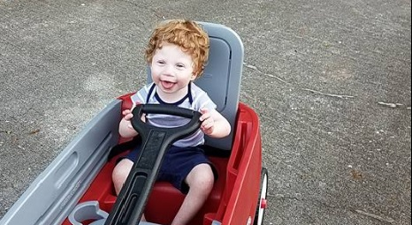 Jaxson takes a ride in his favorite red wagon