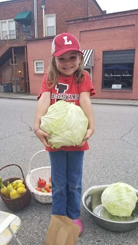 5-year-old Novadonated $376,and became Children'sHospital's youngest donorby selling produce at herparent's farmer's marketin Loudon, Tenn.