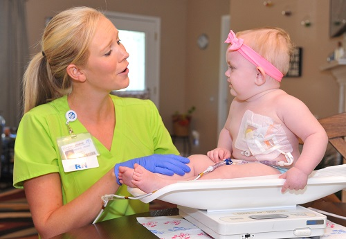 Home health nurse Kayla with Taylor, age 8 months